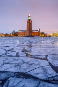 Stockholm's City Hall in winter at dawn with ice blocks in front